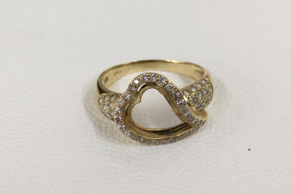 白蝶貝のカット・研磨18金指輪に石留め修理
